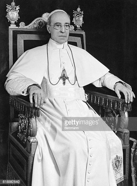 Pope Pius XII sits for an official portrait on his 75th birthday.