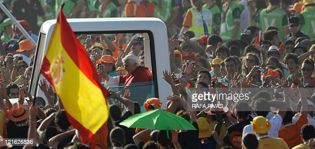 Pope Pope Benedict XVI arrives on his Popemibile to celebrate a mass at the Cuatro Vientos air base outside Madrid during the World Youth Day...