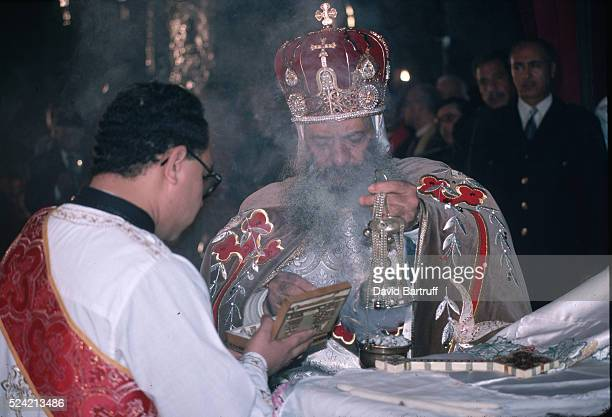 Pope Shenouda III the spiritual leader of the Coptic Christians of Egypt officates at an Epiphany service at St Mark's Cathedral in Cairo Egypt