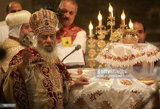 Pope Shenuda III Head of the Egyptian Coptic Orthodox Church blesses believers attending the Coptic Christmas midnight mass in Cairo late 06 January...