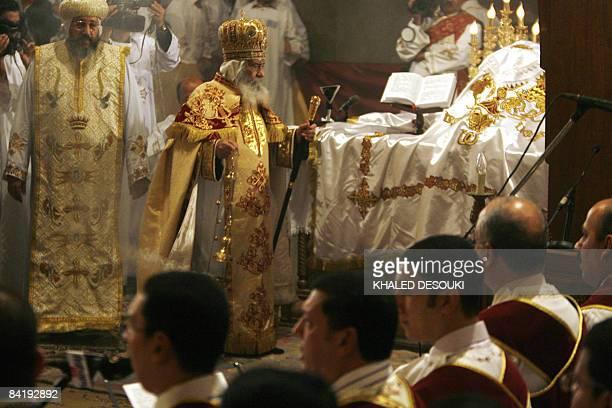 Pope Shenuda III Head of the Egyptian Coptic Orthodox Church leads the Coptic Christmas midnight mass in Cairo late on January 62009 Pope Shenouda...