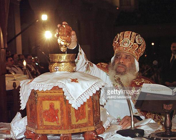 Pope Shenuda III the patriarch of Egypt's Coptic Christians holds a Christmas mass at St Mark Cathedral in Cairo late 06 January 2003 Coptic or...