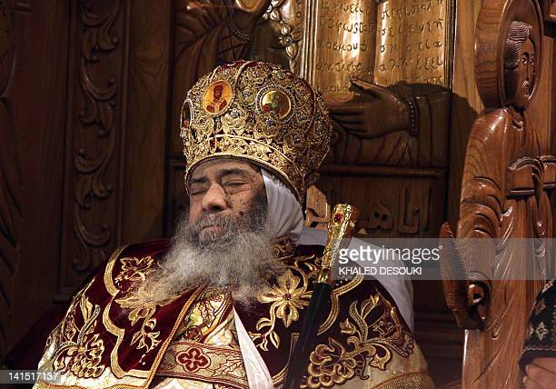 Pope Shenuda III the spiritual leader of the Middle East's largest Christian minority sits dressed in formal robes in at the Saint Mark's Coptic...
