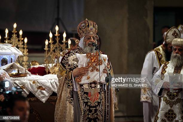 Pope Tawadros II leader of Egypt's Coptic Church leads an Easter service late on April 19 2014 at the Cathedral of Abbasiya in Cairo Copts account...