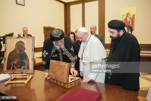 Pope Tawadros II of Alexandria presents a gift to Pope Francis during their meeting at The Saint Mark's Coptic Orthodox Cathedral in Abbassia...