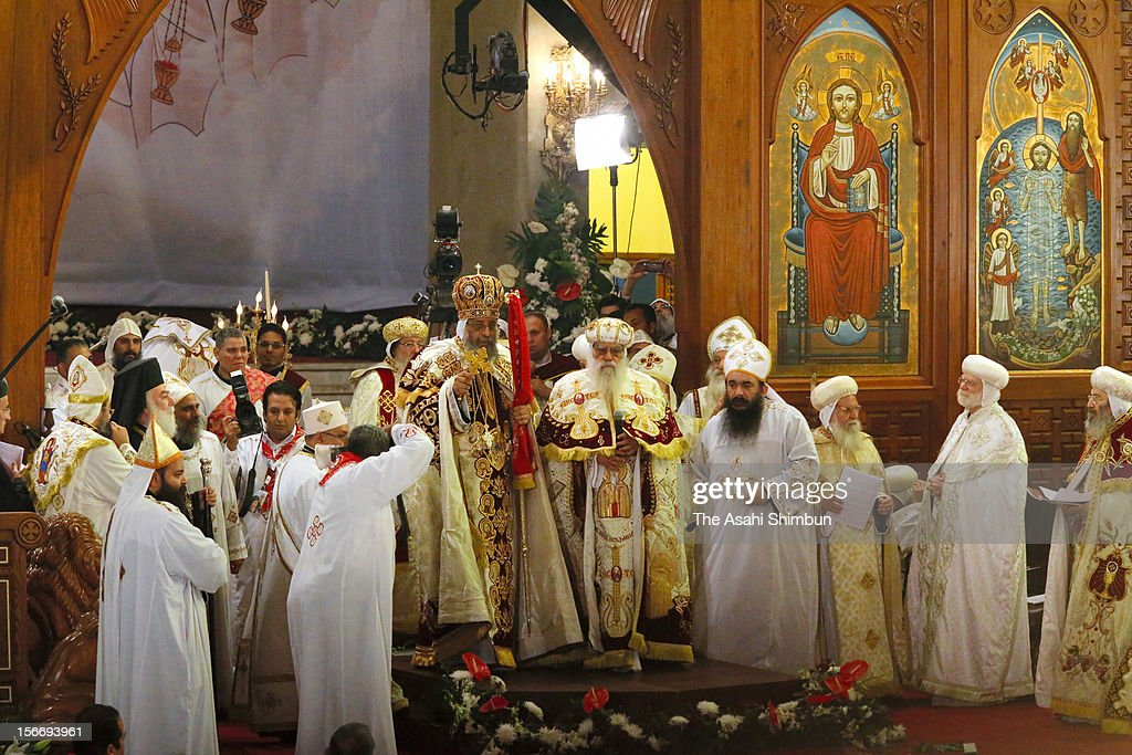 Pope Tawadros II (center left), the new pope of the Coptic Orthodox church, attends his enthronement ceremony at St. Mark Cathedral on November 18, 2012 in Cairo, Egypt.