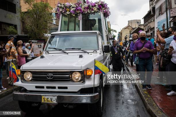 Popemobile carrying a figure of Jesus with the cross leads the Nazareno de San Pablo motorcade procession in the framework of Holy Week celebrations...