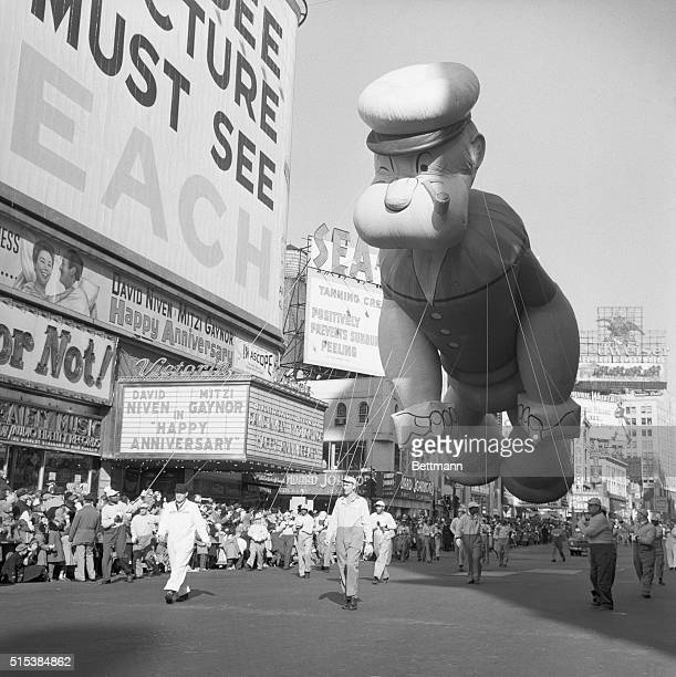 Popeye one of the huge balloons in the annual Macy's Thanksgiving Day Parade makes its way through Times Square