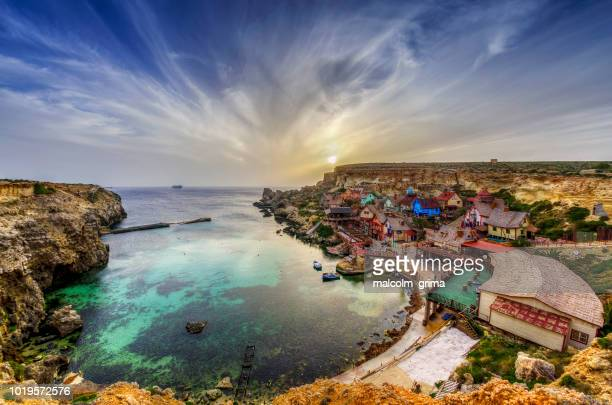 popeye village and anchor bay, mellieha, malta - malta stock pictures, royalty-free photos & images