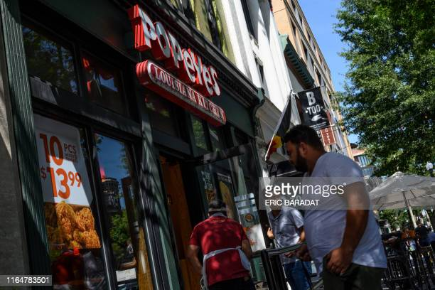 A Popeyes fast food chain restaurant is seen on August 30 2019 on a street of Washington DC Chick it out US restaurant chain Popeyes launched a fried...