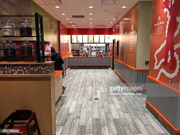 Popeyes Restaurant interior details Long gallery in a food place with colorful walls and dull grey flooring