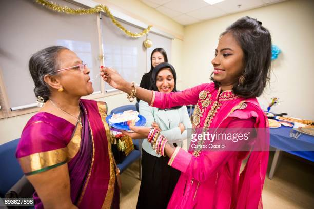 Popi feeds her mother Anajta Das cake during a party thrown for Popi at Toronto General Hospital In September in her hometown in Bangladesh Popi Rani...