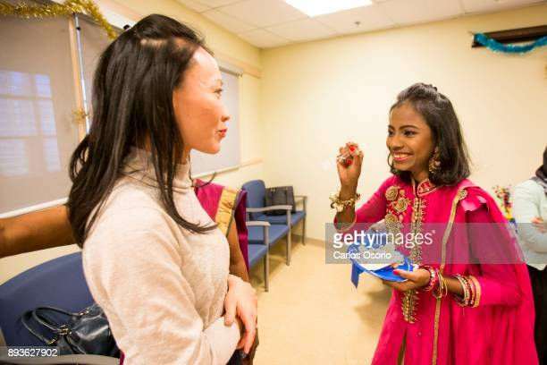 Popi smiles after feeding cake to Dr Toni Zhong during a party thrown for Popi at Toronto General Hospital In September in her hometown in Bangladesh...