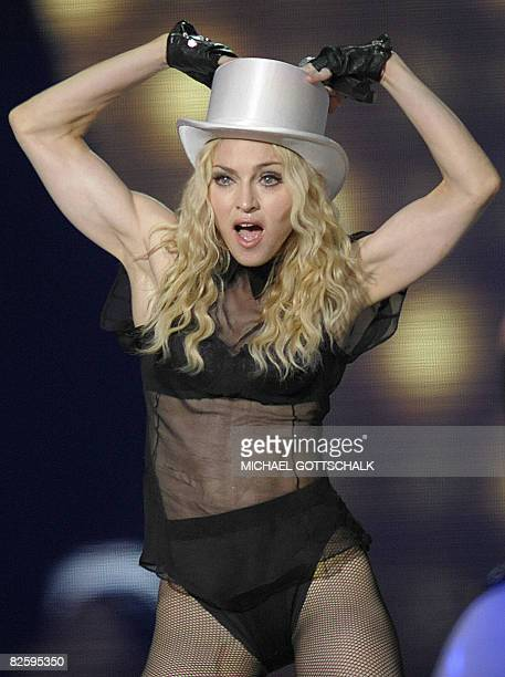 US popicon Madonna performs on stage at Berlin's Olympic stadium on August 28 2008 in Berlin Madonna is on her Sticky And Sweet world tour with a...