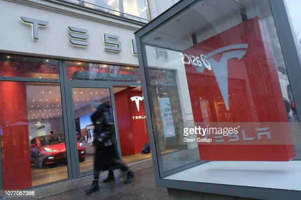 Pople walk past a Tesla dealership on January 4 2019 in Berlin Germany Tesla is expected to soon begin deliveries of the Model 3 in Europe even...