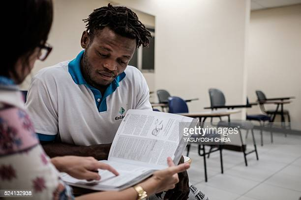 Popole Misenga a refugee judoka from the Democratic Republic of the Congo, takes lessons of Portuguese before a training in Rio de Janeiro, Brazil,...