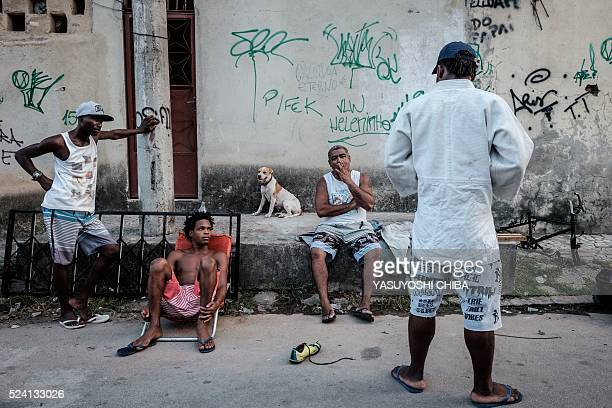 Popole Misenga a refugee judoka from the Democratic Republic of Congo, shows his judogi to neighbors with a sponsor's badge stitched on it near his...