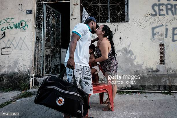 Popole Misenga a refugee judoka from the Democratic Republic of Congo, kisses his partner Fabiana before going to train in Rio de Janeiro, Brazil, on...