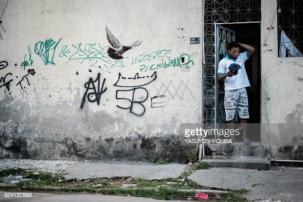 Popole Misenga a refugee judoka from the Democratic Republic of Congo, stands at the entrance of his flat in Rio de Janeiro, Brazil, on April 14,...