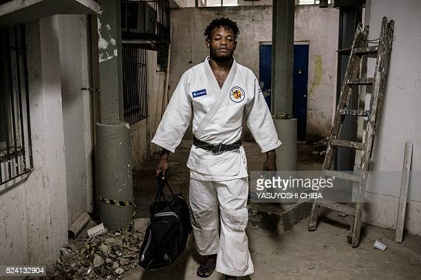 Popole Misenga a refugee judoka from the Democratic Republic of Congo, wears his judogi before a training at Instituto Reacao in Rio de Janeiro,...