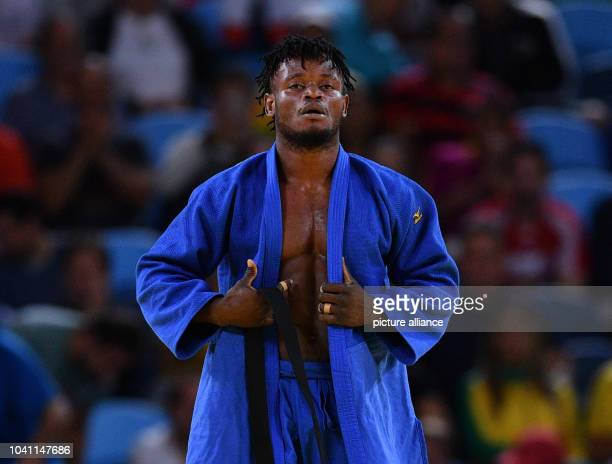 Popole Misenga of Refugee Olympic Team during the Men -90 kg Elimination Round of 32 of the Judo event during the Olympic Games at Carioca Arena 2 in...