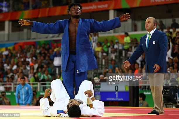Popole Misenga of the Refugee Olympic Team celebrates after defeating Avtar Singh of India during a Men's -90kg bout on Day 5 of the Rio 2016 Olympic...