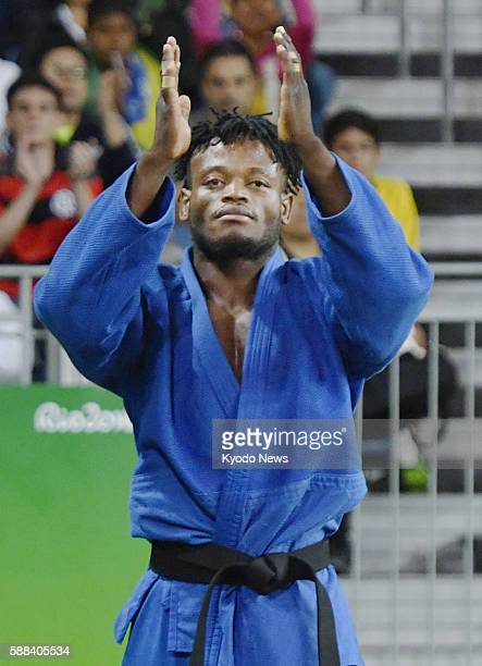 Popole Misenga of the refugee team acknowledges the crowed after being defeated by South Korea's Gwak Dong Han in the men's judo 90-kilogram round of...