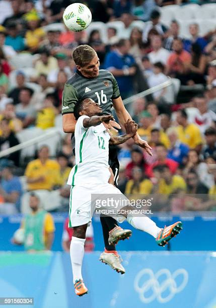 Popoola Saliu of Nigeria vies for the ball with Max Christiansen of Germany during their Rio 2016 Olympic Games mens semifinal football match at the...