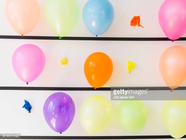 Popped balloons on wall