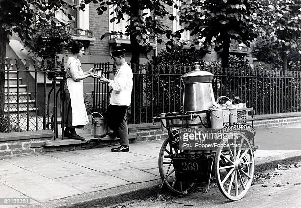 Popperfoto via Getty Images The Book Volume 1 Page 70 Picture 6 A picture of a milkman delivering milk to a maid whilst doing his round with his milk...