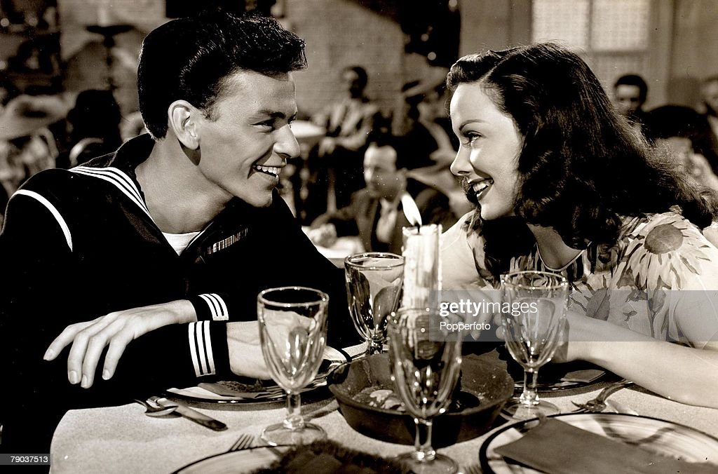 Popperfoto. The Book. Volume 1. Page: 76. Picture:5. 1945. American singer and actor Frank Sinatra is pictured with actress Kathryn Grayson in a scene from the film 'Anchors Aweigh'. : News Photo