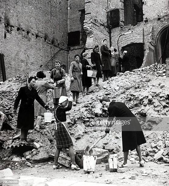 Popperfoto The Book Volume 1 Page 82 Picture 4 World War II A picture of some German women cleaning up the debris from the bomb shattered buildings...