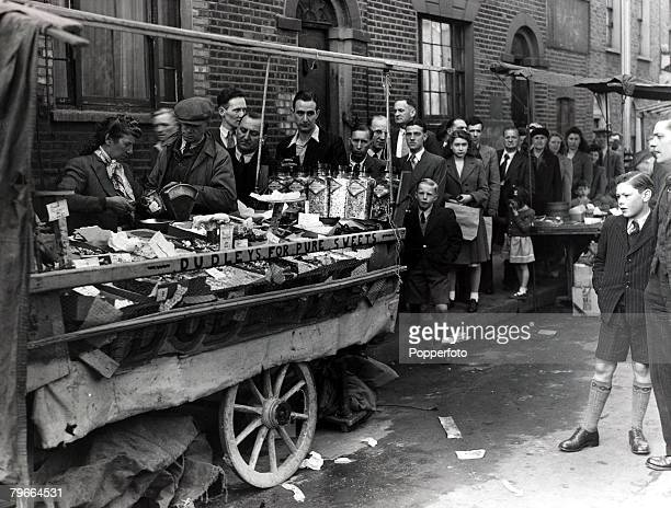 Popperfoto via Getty Images The Book Volume 1 Page 84 Picture 9 Post World War II 24th April 1949 A picture of people queuing for sweets at a stall...