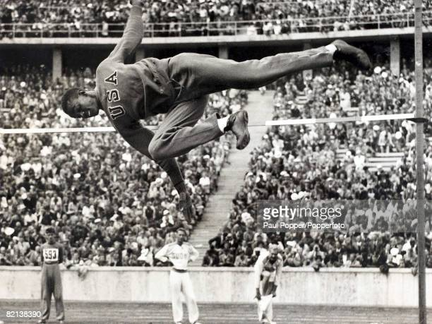 Popperfoto The Book Volume 1 Page 89 Picture 8 1936 Olympic games in Berlin A picture of the Gold medalist Cornelius Johnson midflight during the...