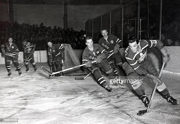 Popperfoto via Getty Images The Book Volume 1 Page 90 Picture 6 Winter Olympics at Oslo Picture showing Ice Hockey action during the game between...