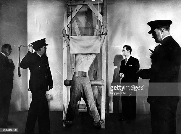 Popperfoto via Getty ImagesThe Book Volume 1Page 100 Picture 8 Corporal Punishment Picture shows a flogging taking place with the prisoner strapped...