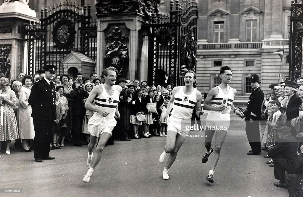 6, 14th July 1958, British runners l-r, Chris Chataway, Roger Bannister and Peter Driver leave Buckingham Palace carrying the silver baton containing message from the Queen to announce the start of the Empire Games to be held in Cardiff