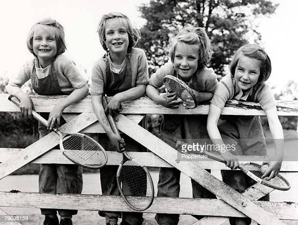 Popperfoto via Getty ImagesThe Book Volume 1Page 96 Picture 3 Quads' 7th birthday four girls with their tennis rackets 1955