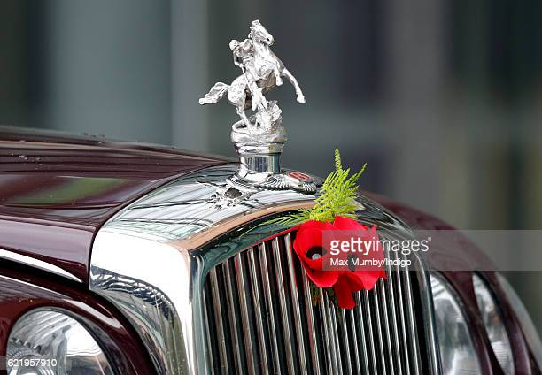 Poppies adorn the bonnet of Queen Elizabeth II's Bentley car as she opens the Francis Crick Institute on November 9 2016 in London England The...