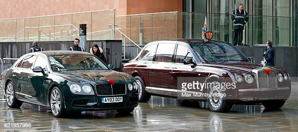 Poppies adorn the bonnets of Prince Andrew Duke of York's and Queen Elizabeth II's Bentley cars at the opening the Francis Crick Institute on...