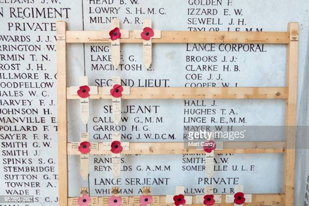 Poppies and crosses are left besides the names of the fallen inscribed on the Menin Gate Memorial as they gather for the Last Post ceremony at the...