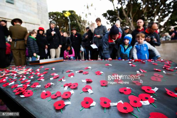 Poppies are laid on the Tomb of the Unknown Warrior during Anzac Day dawn service at Pukeahu National War Memorial Park on April 25 2017 in...