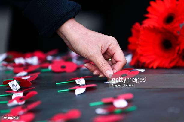 Poppies are laid on the Tomb of the Unknown Warrior during the Anzac Day Dawn Service at Pukeahu National War Memorial Park on April 25 2018 in...