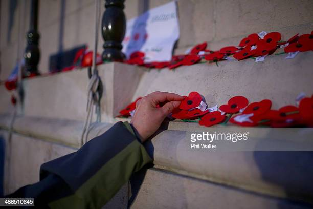 Poppies are placed on the cenotaph at the War Memorial Museum on April 25 2014 in Auckland New Zealand Veterans dignitaries and members of the public...