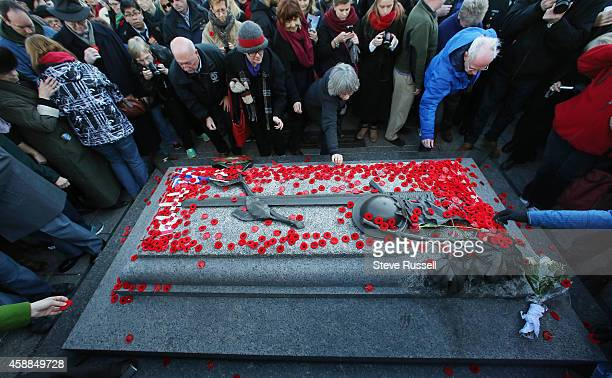 OTTAWA ON NOVEMBER 11 Poppies are placed on the Tomb of the Unknown Soldier The nation's capital observes Remembrance Day at the National War...
