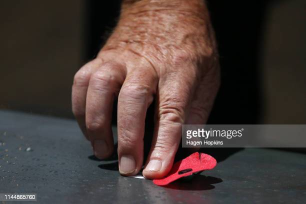 Poppies are placed on the Tomb of the Unknown Warrior during the Anzac Day Dawn Service at Pukeahu National War Memorial Park on April 25 2019 in...