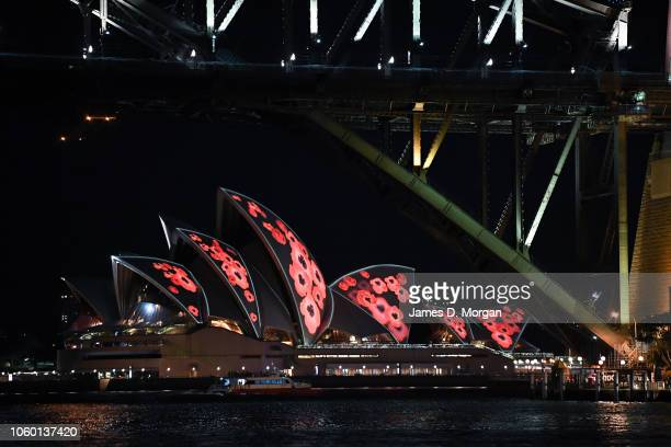 Poppies are projected onto the sails of the Opera House with the foreground of the Harbour Bridge on November 11 2018 in Sydney Australia Remembrance...