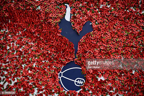 Poppies are stuck to the Tottenham Hotspur badge ahead of the Rememberance Day outside the stadium prior to kick off during the Premier League match...