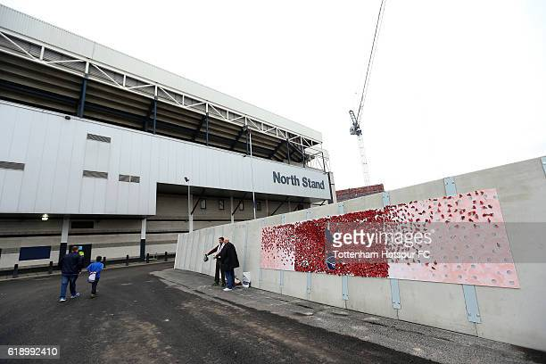 Poppies are stuck to the Tottenham Hotspur badge outside the stadium prior to kick off during the Premier League match between Tottenham Hotspur and...