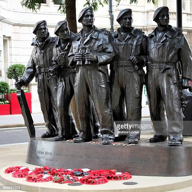Poppies at the Royal Tank Regiment Memorial, located on the corner of Whitehall Court and Whitehall Place in London, England. The memorial depicts...